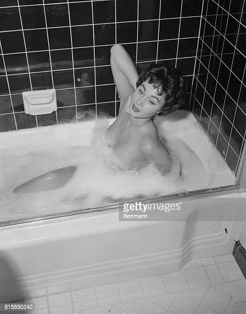 All this starts when pretty Marla English film starlet scrubs her shapely legs and soaps her comely back as she gets ready to attend a Hollywood...