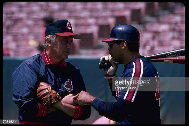 All time great Atlanta Braves pitcher Phil Niekro now a coach of the Cleveland Indians talks with Reggie Jackson Mandatory Credit Steve Dunn/Allsport