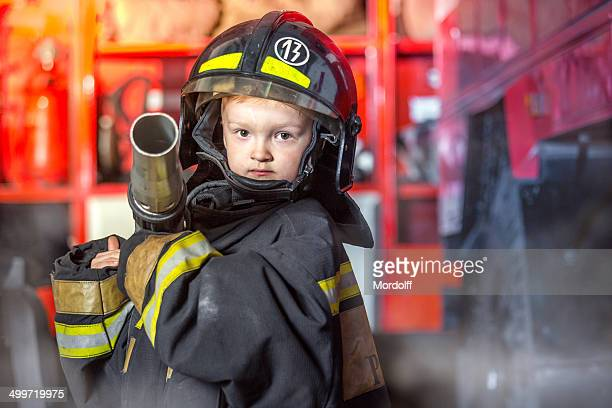 all to extinguish fire - firefighter stock pictures, royalty-free photos & images