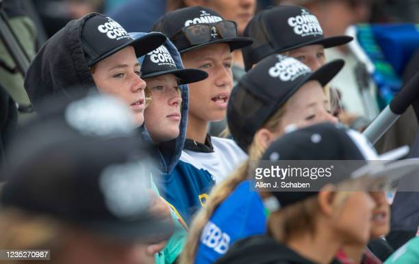 All wearing Conner Coffin hats, young fans watch their favorite surfer, Conner Coffin, of Santa Barbara, compete against Morgan Cibilic, whom he...