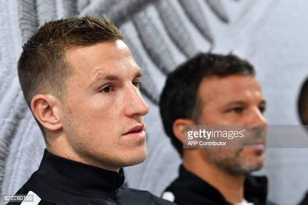 All Whites player Chris Wood speaks to the media with coach Anthony Hudson during a media and training session at Westpac Stadium in Wellington New...