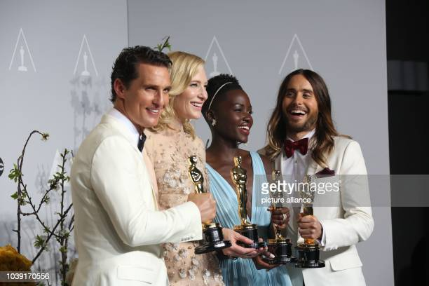 All winners in acting categories Matthew McConaughey Cate Blanchett Lupita Nyong'o and Jared Leto pose in the press room of the 86th Academy Awards...