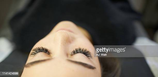 all you need is longer lashes! - false eyelash stock pictures, royalty-free photos & images