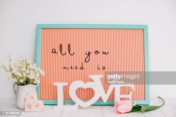 all you need is love  text  neon  text in mockup - february background stock pictures, royalty-free photos & images