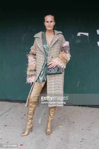 Alla Kostromichova is seen wearing a Land of Distraction dress and a Gucci purse on the street during New York Fashion Week on September 11 2018 in...