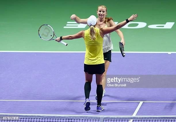 Alla Kudryavtseva of Russia and Anastasia Rodionova of Australia celebrate match point after their three set victory against Ekaterina Makarova and...