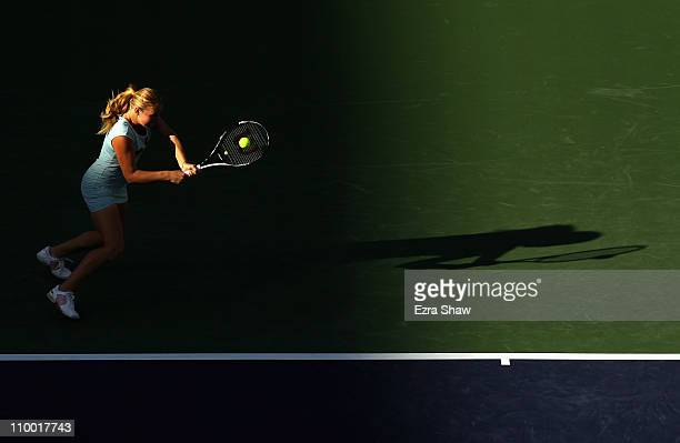 Alla Kudryavtseva of Russia returns a shot to Kim Clijsters of Belgium during the BNP Paribas Open at the Indian Wells Tennis Garden on March 11 2011...