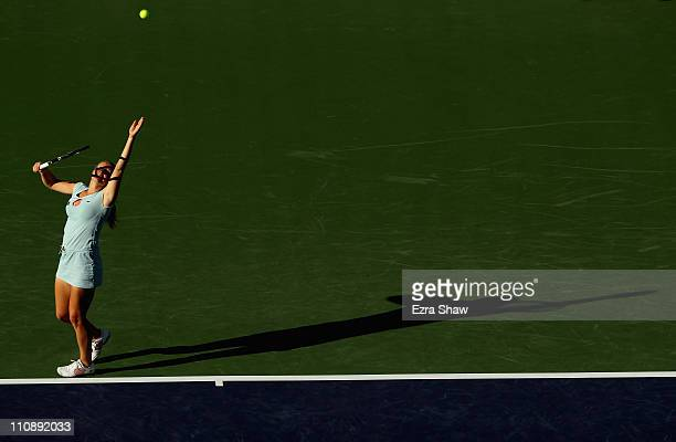 Alla Kudryavtseva of Russia serves to Kim Clijsters of Belgium during the BNP Paribas Open at the Indian Wells Tennis Garden on March 11 2011 in...