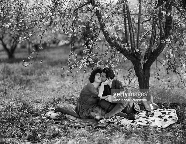Alla Nazimova and Rudolph Valentino are the illfated lovers in 'Camille' directed by Ray C Smallwood and based on the novel 'La Dame aux Camelias' by...