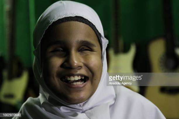 Allafta Hirzi Sodiq gestures during an interview at the Special Needs department of the Lebak Bulus National School in Jakarta Indonesia on July 20...