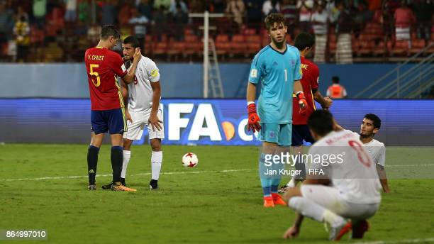 Allahyar Sayyad of Iran is consoled by Victor Chust of Spain at the final whistle during the FIFA U17 World Cup India 2017 Quarter Final match...