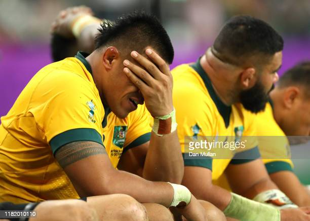 Allan Alaalatoa of Australia looks dejected on the bench with team mates during the Rugby World Cup 2019 Quarter Final match between England and...