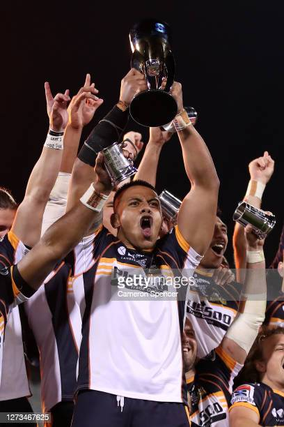 Allan Alaalatoa of the Brumbies holds aloft the Super Rugby AU trophy after winning the Super Rugby AU Grand Final between the Brumbies and the Reds...