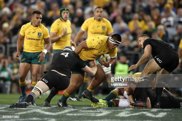 Allan Alaalatoa of the Wallabies is tackled by Brodie Retallick of the All Blacks during The Rugby Championship Bledisloe Cup match between the...