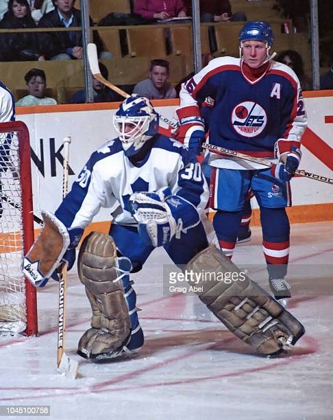Allan Bester of the Toronto Maple Leafs skates against Thomas Steen of the Winnipeg Jets during NHL game action on March 17 1990 at Air Canada Centre...