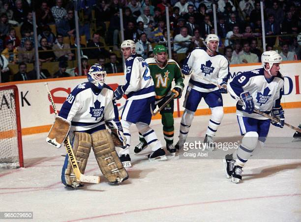 Allan Bester Tom Kurvers Al Iafrate and Dave Hannan of the Toronto Maple Leafs skate against Brian Bellows of the Minnesota North Stars during NHL...