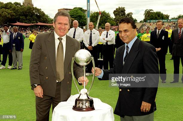Allan Border former Australian cricket captain and Sunil Gavaskar former Indian cricket captain pose for a photo with the 'BorderGavaskar Trophy...