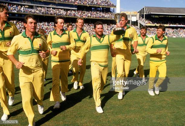 Allan Border of Australia holds aloft the world series cup after the Benson Hedges World Series Cup 2nd final match between Australia and India at...