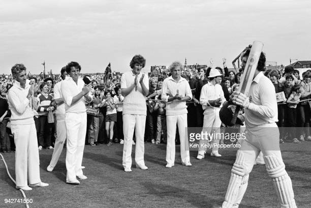 Allan Border of Australia is applauded off the field by the England players and spectators after ending the match on 123 not out in the 5th Test...