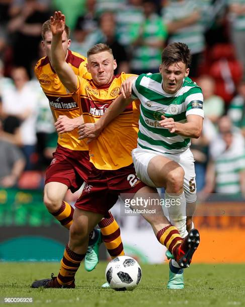 Allan Campbell of Motherwell and Kieran Tierney of Celtic battle for the ball during the Scottish Cup Final between Motherwell and Celtic at Hampden...