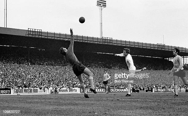 Allan Clarke of Leeds United scores past Pat Jennings of Tottenham Hotspur during their Division One match at Elland Road Leeds on 9th August 1969
