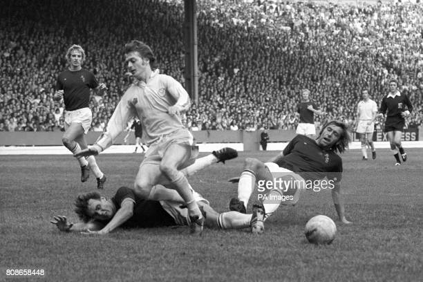 Allan Clarke the Leeds United forward centre as he creates havoc with Burnley whose defender Keith Newton is on the right Burnley won the match 21