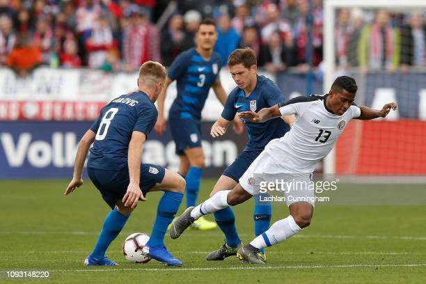 Allan Cruz of Costa Rica competes for the ball against Wil Trapp and Djordje Mihailovic of the United States at Avaya Stadium on February 2 2019 in...