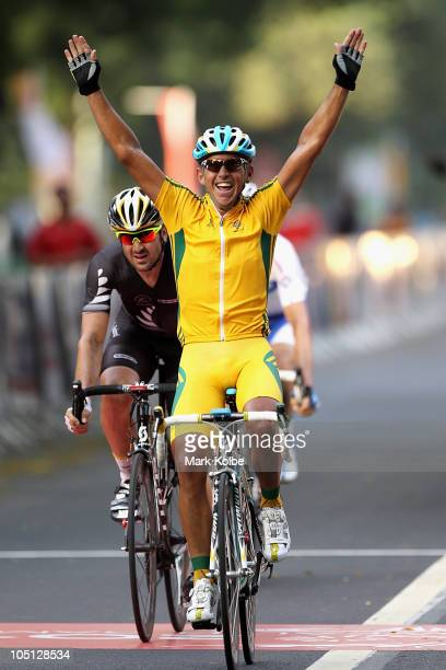 Allan Davis of Australia celebrates finishing the Men's Road Race in first place and wins the gold medal during day seven of the Delhi 2010...