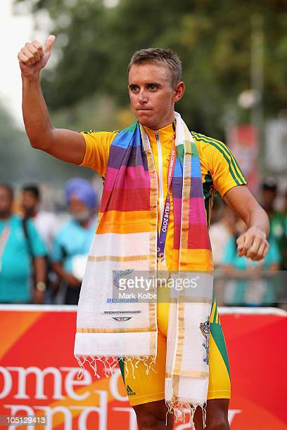 Allan Davis of Australia poses with the gold medal during the medal ceremony for the Men's Road Race during day seven of the Delhi 2010 Commonwealth...