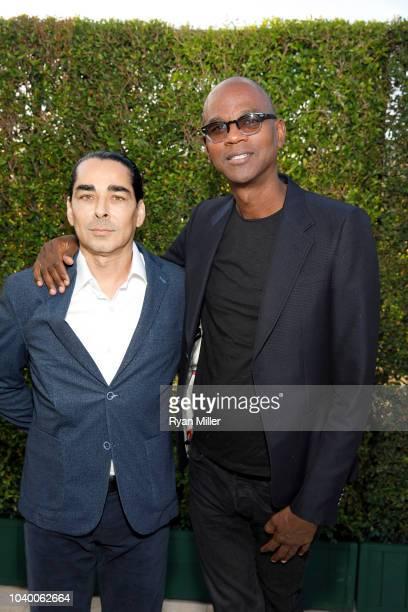 Allan DiCastro and artist Mark Bradford attend the J Paul Getty Medal Dinner on September 24 2018 in Los Angeles California