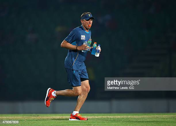 Allan Donald bowling coach of South Africa carries water to his players during the ICC World Twenty20 Bangladesh 2014 Warm Up match between South...