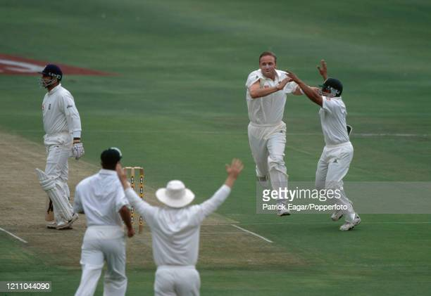 Allan Donald of South Africa celebrates with teammate Paul Adams after taking the wicket of England batsman Mark Butcher, caught for 1 run by South...