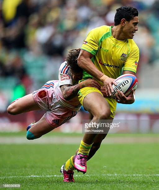 Allan Fa'alava'au of Australia is tackled by Terry Bouhraoua of France during the Marriottt London Sevens Day One at Twickenham on May 11 2013 in...