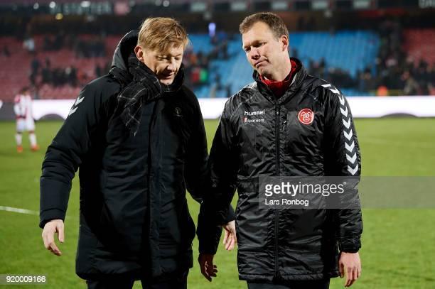 Allan Gaarde sports director of AaB Aalborg speaks to Morten Wieghorst head coach of AaB Aalborg after the Danish Alka Superliga match between AaB...