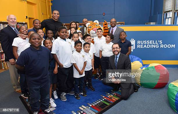 Allan Gilreath of Scholastic Russell Westbrook and students launch 'RUSSELL'S READING ROOM' at 75th Street Elementary on August 21 2015 in Los...