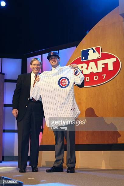 "Allan H. ""Bud"" Selig, Major League Baseball Commissioner, left and Joshua Vitters, first round pick of the Chicago Cubs smile for a photo during the..."