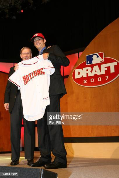 "Allan H. ""Bud"" Selig, Major League Baseball Commissioner, left and Ross Detwiler, first round pick of the Washington Nationals smile for a photo..."