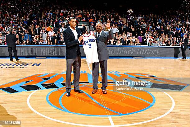 edf3ca7c8 Allan Houston left and John Rucker former New York Knicks players stand on  court for a