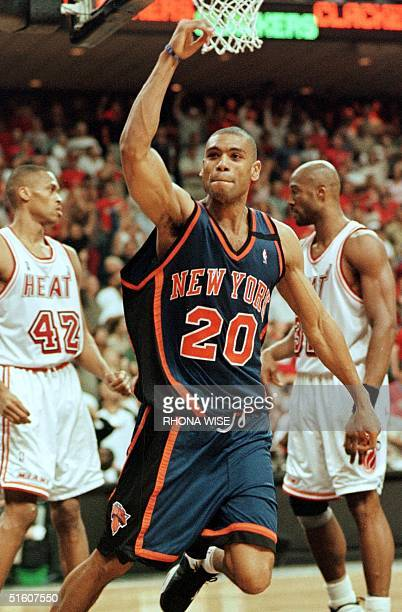 Allan Houston of the New York Knicks celebrates his gamewinning shot in front of PJ Brown and Alonzo Mourning of the Miami Heat16 May 1999 during...