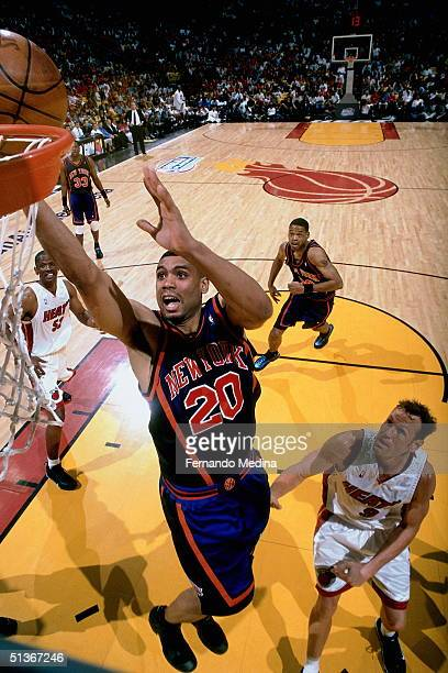 Allan Houston of the New York Knicks drives to the basket for a layup against the Miami Heat during an NBA game on May 16 2000 at American Airlines...