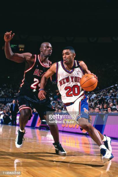 Allan Houston of the New York Knicks handles the ball against Jamal Mashburn of the Miami Heat on February 7 1999 at the Madison Square Garden in New...