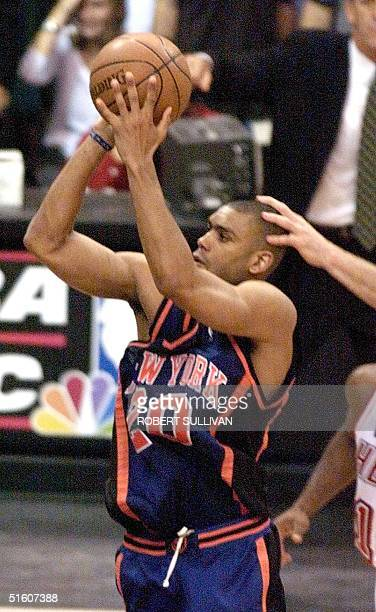Allan Houston of the New York Knicks makes the game winning shot against the Miami Heat 16 May during game five of their 1st round playoff game at...