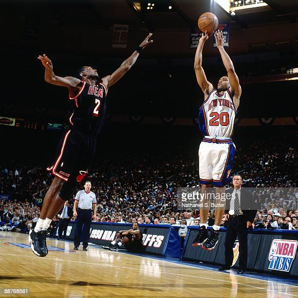 Allan Houston of the New York Knicks shoots a jump shot against Keith Askins of the Miami Heat in Game Three of the Eastern Conference Quarterfinals...