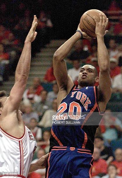 Allan Houston of the New York Knicks shoots over Dan Majerle of the Miami Heat during game one of their first round playoff 08 May 1999 at the Miami...