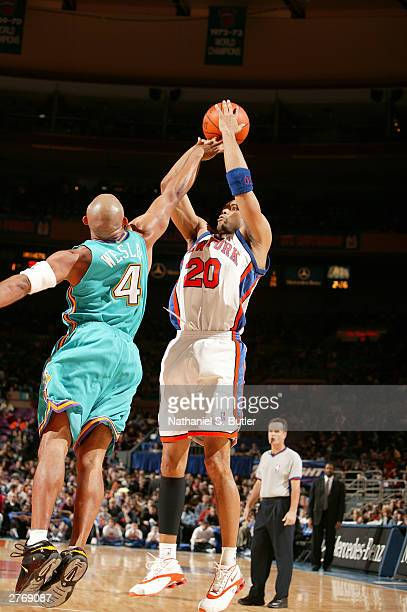 Allan Houston of the New York Knicks shoots over David Wesley of the New Orleans Hornets on November 29 2003 at Madison Square Garden in New York...