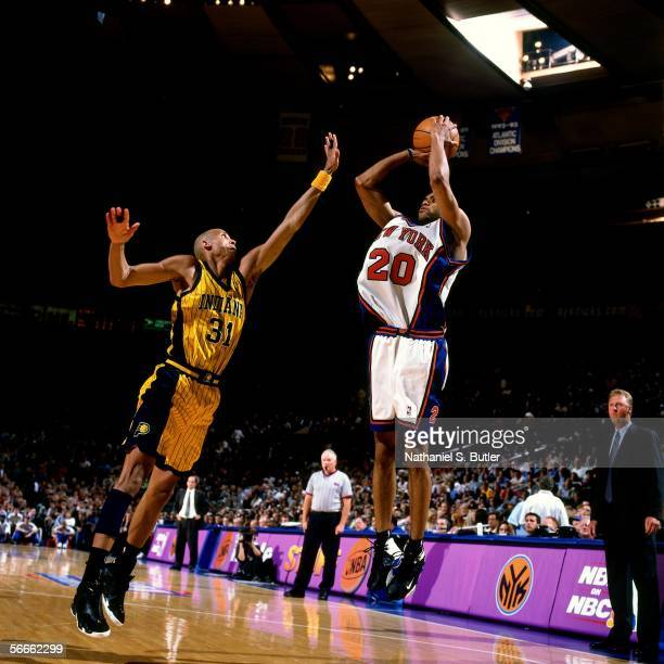 Allan Houston of the New York Knicks shoots over Reggie Miller of the Indiana Pacers on June 11 1999 at Madison Square Garden in New York New York...