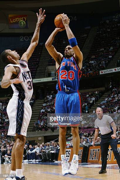 Allan Houston of the New York Knicks takes a jump shot over Kerry Kittles of the New Jersey Nets during the game at Continental Airlines Arena on...