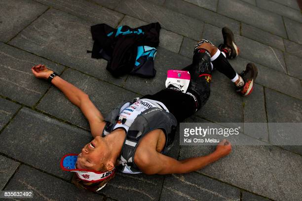 Allan Hovda collapses after the finishline at The Arctic Triple // Lofoten Triathlon Extreme distance on August 19 2017 in Svolvar Norway Lofoten...