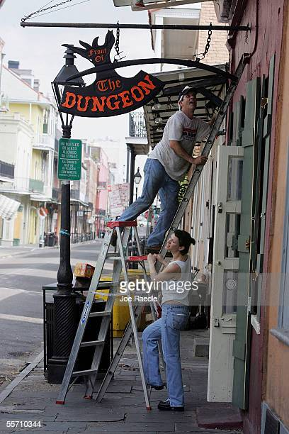 Allan Kagan and his wife Rachel Kagan install the sign above the entrance to their bar The Dungeon that they have owned for 15 years September 17...