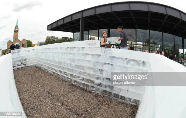 Allan Kaprow's 'Fluids' is recreated during the Berlin Art Week in front of the New National Gallery in Berlin Germany 15 September 2015 Alan Kaprow...